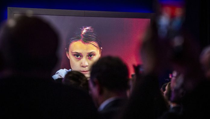Greta Thunberg in Davos advised to listen to science