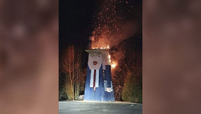 In Slovenia, the unknown burned a wooden statue of Donald trump
