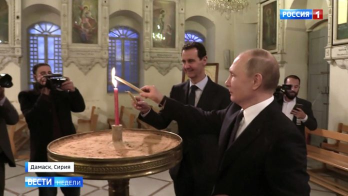 Putin and Assad put a candle for peace