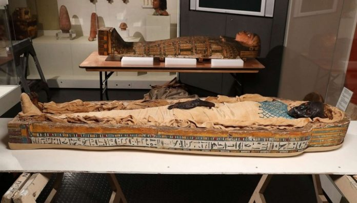 The mystery of the mummy Takebut: how killing a woman with an extra vertebra and an extra tooth