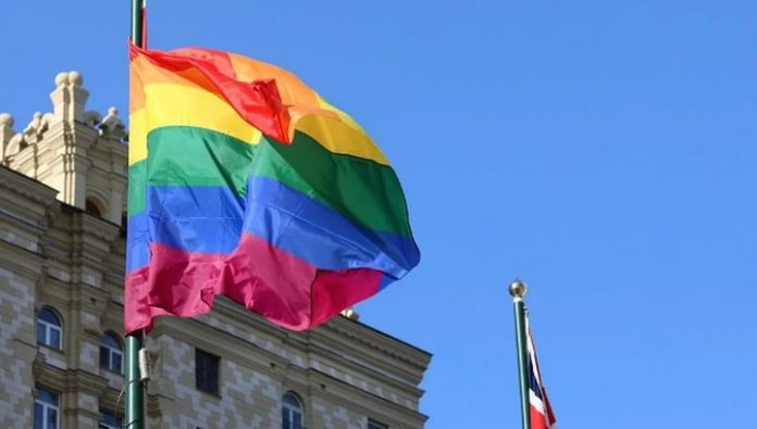 British diplomats hoisted a rainbow flag behind the American colleagues